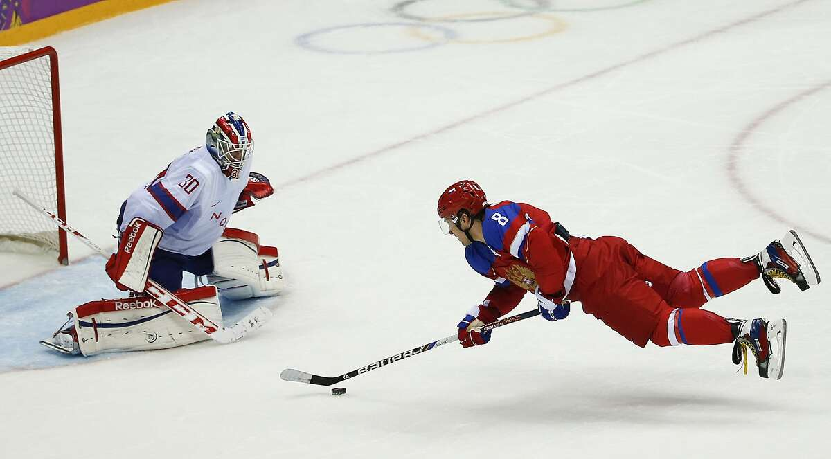 Russia forward Alexander Ovechkin makes an off-balance shot against Norway goaltender Lars Haugen in the third period of a men's ice hockey game at the 2014 Winter Olympics, Tuesday, Feb. 18, 2014, in Sochi, Russia.