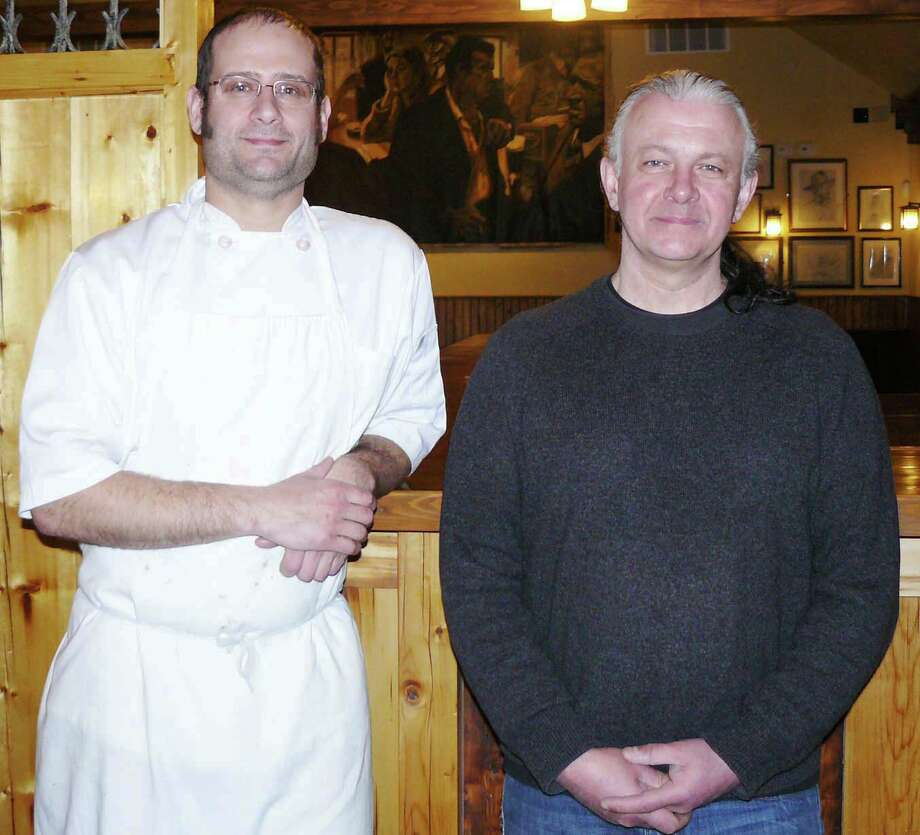 Patrick Mansfield, right, engaged a trained chef, David Hamilton, to offer fine food as well as traditional Irish favorites at his new Irish bar and restaurant, Anna Liffey's, 1494 Post Road. Photo: Staff Photo/Gretchen Webster / Fairfield Citizen