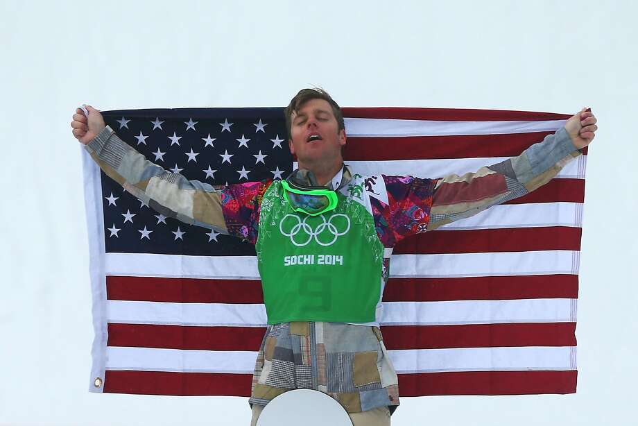 Bronze medalist Alex Deibold of the United States celebrates on the podium during the flower ceremony for the Men's Snowboard Cross Final on day eleven of the 2014 Winter Olympics at Rosa Khutor Extreme Park on February 18, 2014 in Sochi, Russia.  Photo: Mike Ehrmann, Getty Images