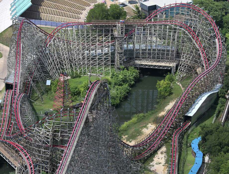 FILE - This July 20, 2013, file aerial photo shows the Texas Giant roller coaster at Six Flags Over Texas, in Arlington, Texas. The death of a woman who fell 75 feet from Six Flags Over Texas' Texas Giant roller coaster is reinvigorating discussion among safety experts about whether it's time to create more consistent, stringent regulations for thrill rides across the nation. (AP Photo/The Dallas Morning News, Louis DeLuca, File) Photo: Louis DeLuca, MBR / The Dallas Morning News