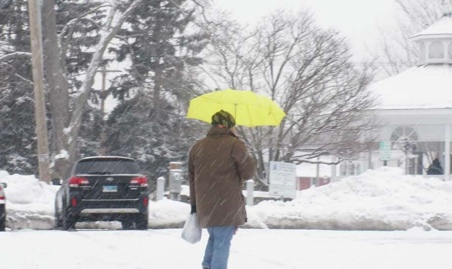 Winter weary residents seemed to take Tuesday's snowfall in stride, perhaps buoyed by the thought of warmer temperatures just a day or two away. Photo: Genevieve Reilly / Fairfield Citizen