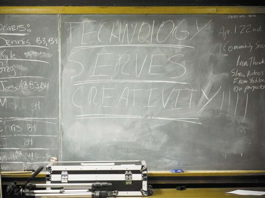 "A chalkboard on the wall in the studio of the Media Technology class at AITE reads ""Technology serves creativitity."" Photo: Kerry Sherck / Stamford Advocate"