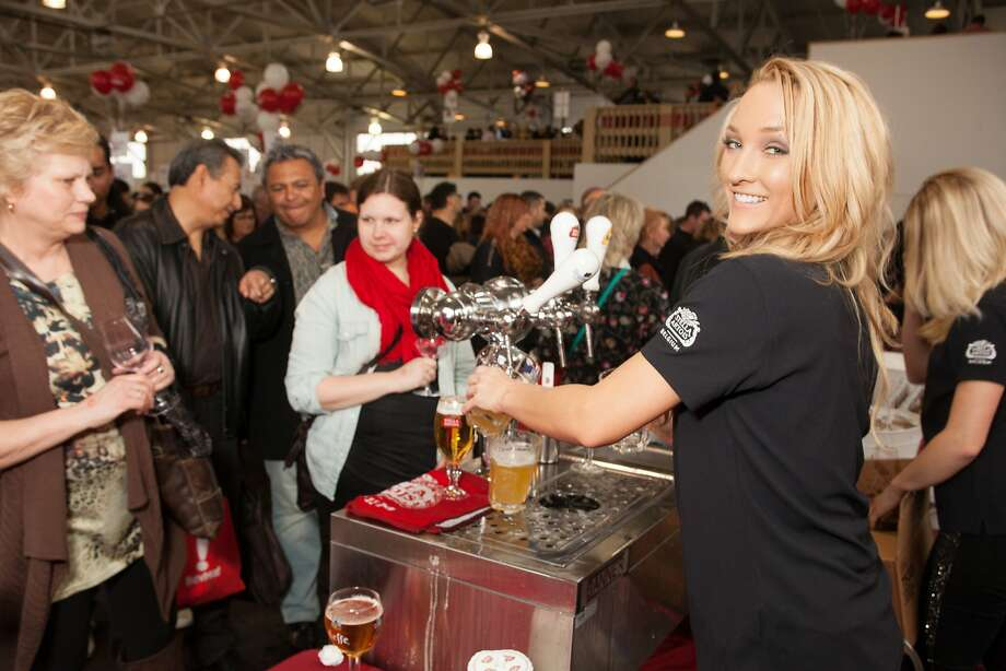 Olivia Leathers pours at the Stella Artois booth at the San Francisco Chronicle Wine Competition Public Tasting on Feb. 15, 2014, at Fort Mason in San Francisco. Photo: Dan Dion- Special To The Chronic, Special To The Chronicle