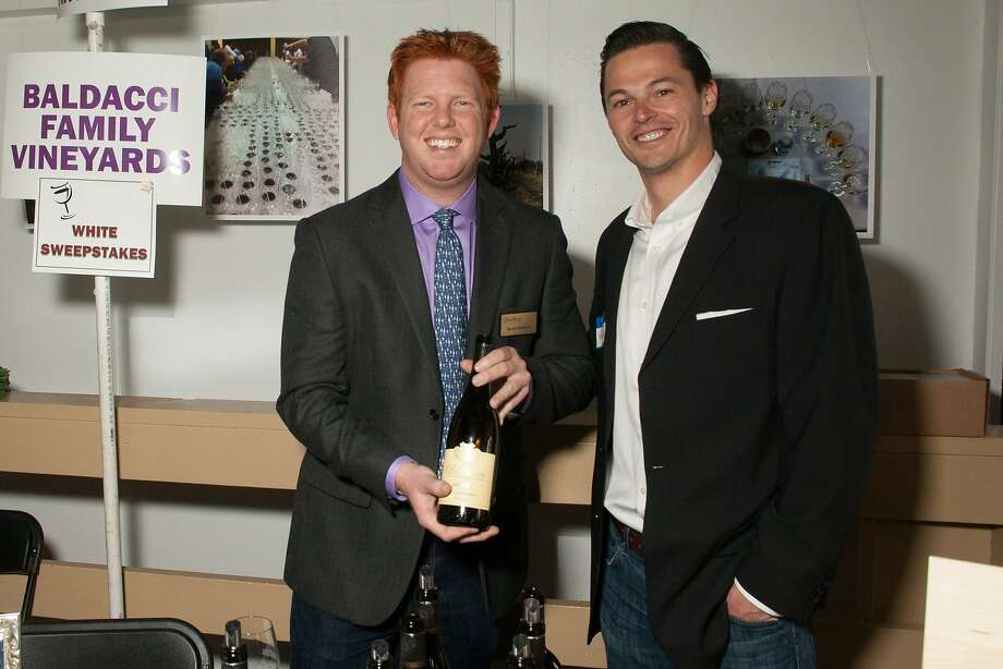 Kevin Baldacchi (Marketing) and Matt Mills (Direct to Consumer) of Baldacchi Winery, winner of the white sweepstakes,  at the San Francisco Chronicle Wine Competition Public Tasting on Feb. 15, 2014, at Fort Mason in San Francisco. Photo: Dan Dion- Special To The Chronic, Special To The Chronicle