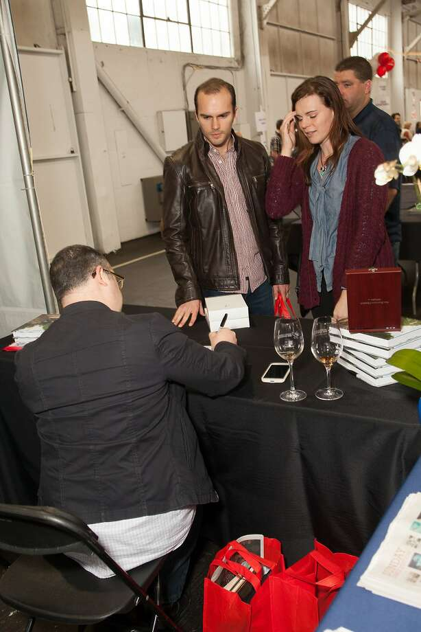 Jon Bonné signs his book at the San Francisco Chronicle Wine Competition Public Tasting on Feb. 15, 2014, at Fort Mason in San Francisco. Photo: Dan Dion- Special To The Chronic, Special To The Chronicle
