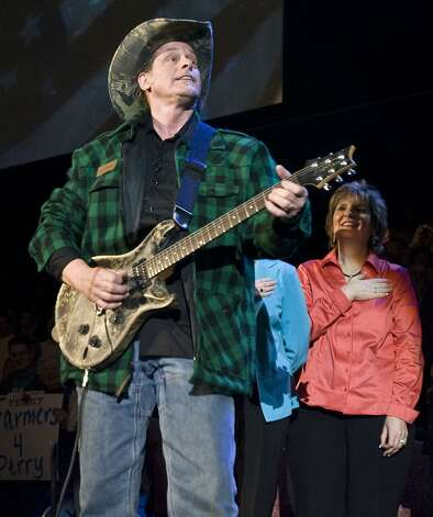 Ted Nugent play the national anthem at a political where Former Alaska Governor Sarah Palin endorses Texas Governor Rick Perry reelection campaign at Cy-Fair ISD's Berry Center Sunday, Feb. 7, 2010, in Cypress.