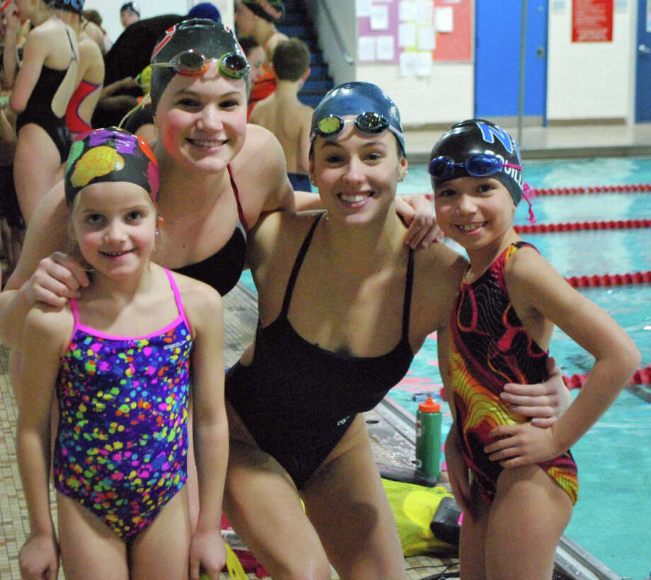 From left, Chloe Wall, Megan Egan, Kristen Moss and Katherine Squillante pose together as ìswim buddiesî during the New Canaan YMCAís Caimans swim practice Monday, Feb. 10. Photo: Contributed Photo, Contributed / New Canaan News Contributed