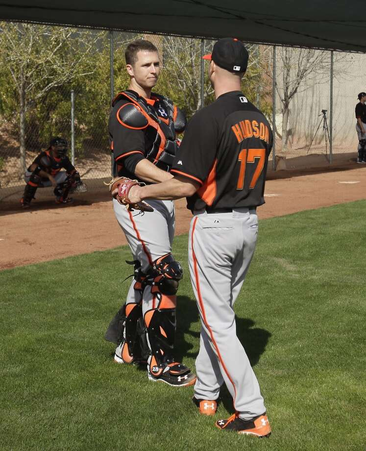 Giants catcher Buster Posey talks to Tim Hudson during camp at Scottsdale Stadium. Photo: Rick Scuteri/USA Today Sports, Reuters
