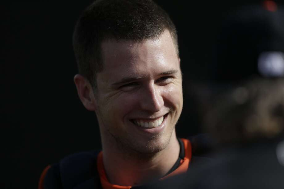 San Francisco Giants catcher Buster Posey looks on during spring training baseball practice Sunday, Feb. 16, 2014, in Scottsdale, Ariz. Photo: Gregory Bull, Associated Press