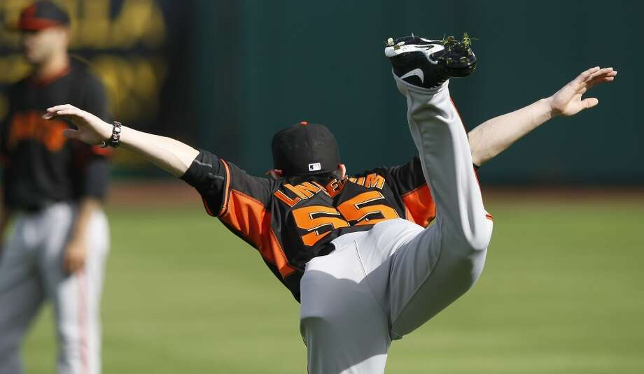 Giants starting pitcher Tim Lincecum (55) stretches during camp at Scottsdale Stadium. Photo: Rick Scuteri/USA Today Sports, Reuters