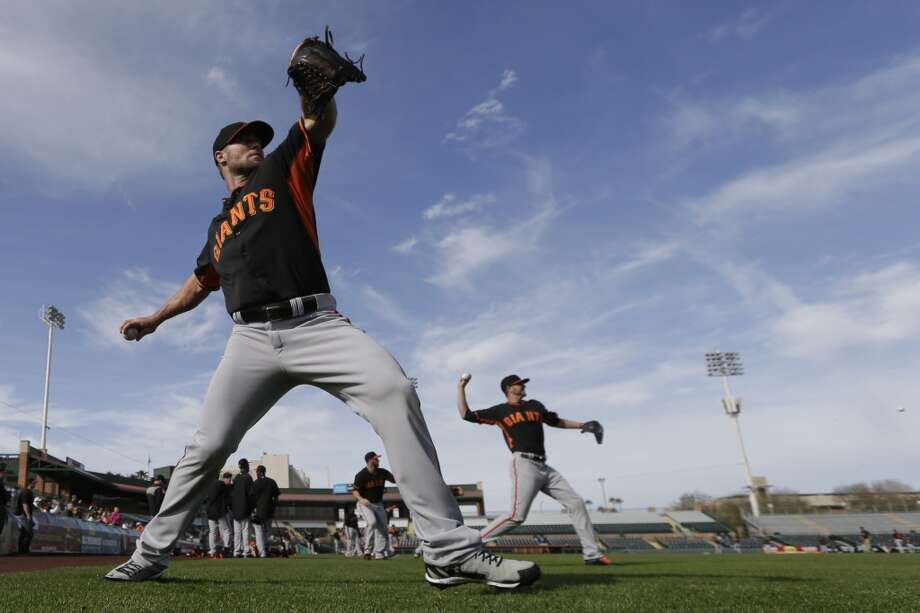 San Francisco Giants pitcher Hunter Strickland, left, and Giants invitee Chris Heston, right, warm up during spring training baseball practice on Sunday, Feb. 16, 2014, in Scottsdale, Ariz. Photo: Gregory Bull, Associated Press