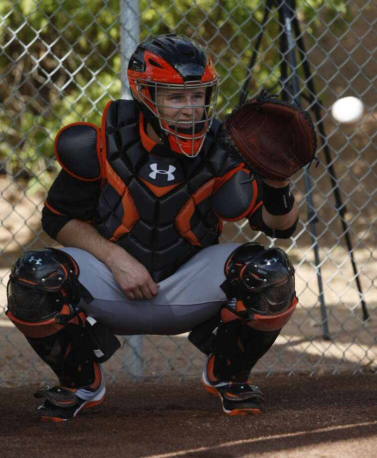 Giants catcher Buster Posey warms up during camp at Scottsdale Stadium. Photo: Rick Scuteri/USA Today Sports, Reuters