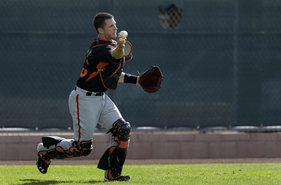 San Francisco Giants catcher Buster Posey throws during spring training baseball practice on Sunday, Feb. 16, 2014, in Scottsdale, Ariz. Photo: Gregory Bull, Associated Press