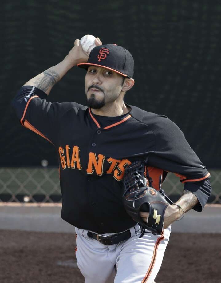 San Francisco Giants relief pitcher Sergio Romo throws during spring training baseball practice Sunday, Feb. 16, 2014, in Scottsdale, Ariz. Photo: Gregory Bull, Associated Press