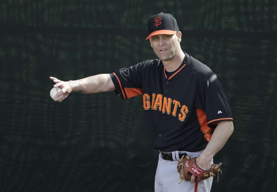 San Francisco Giants pitcher Tim Hudson throws during spring training baseball practice Sunday, Feb. 16, 2014, in Scottsdale, Ariz. Photo: Gregory Bull, Associated Press