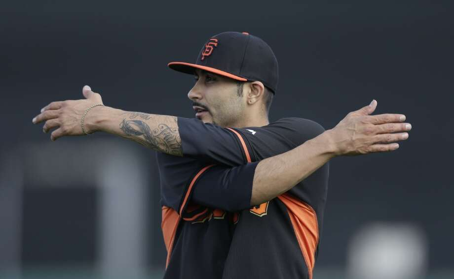 San Francisco Giants relief pitcher Sergio Romo stretches during spring training baseball practice Sunday, Feb. 16, 2014, in Scottsdale, Ariz. Photo: Gregory Bull, Associated Press