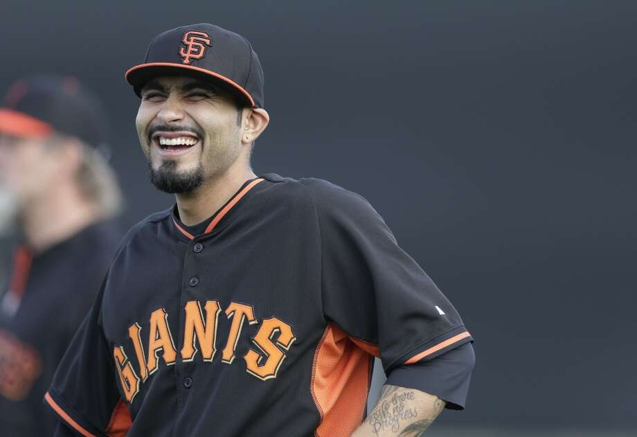 San Francisco Giants relief pitcher Sergio Romo smiles during spring training baseball practice Sunday, Feb. 16, 2014, in Scottsdale, Ariz. Photo: Gregory Bull, Associated Press
