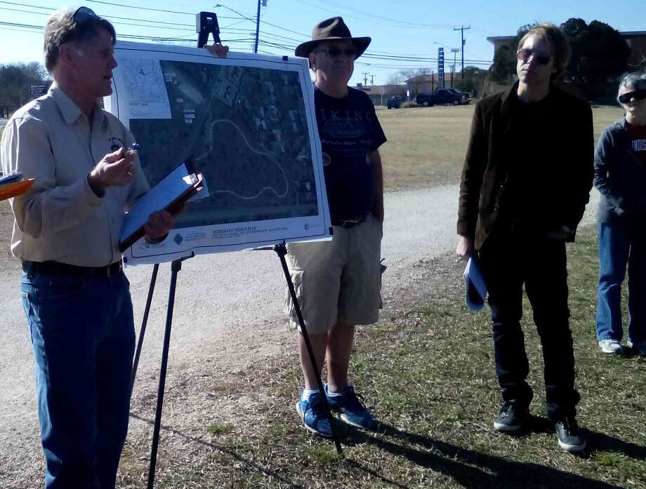 Mark Wittlinger, left, with the city of San Antonio, and Erik Sanden, front right, president of the Shearer Hills/Ridgeview Neighborhood Association, discuss improvements planned for Olmos Basin Park in a Feb. 8 meeting with neighbors at the park. Photo: Edmond Ortiz / Alamo Heights Weekly