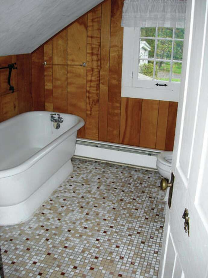 Before: White and WoodWhen the owners of this weekend house first saw this bathroom, they knew it wouldn't take much labor or investment to freshen it up. Paint could easily lighten the space, but the biggest concern was the mosaic-tile floor, which looked drab.