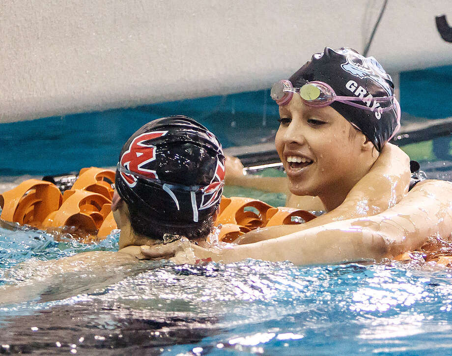 Johnson's Raquel Grays, right, and Churchill's Megan Strickland celebrate after last year's Class 5A state finals in the girls 50-yard freestyle. Photo: Marvin Pfeiffer/Stone Oak Weekly / Express-News 2013