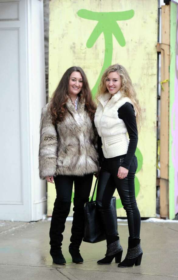 Sisters, Michelle, left, and Cristina Spinei of Stamford, pose wearing their winter clothes on Greenwich Avenue, Greenwich Conn., Tuesday afternoon, Feb. 18, 2014. Photo: Bob Luckey / Greenwich Time