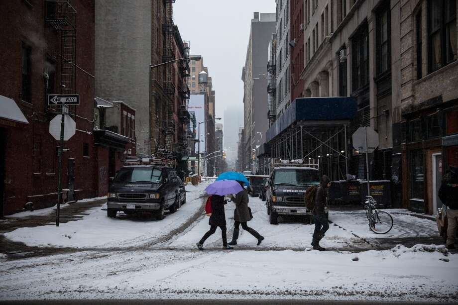 NEW YORK, NY - FEBRUARY 18:  People walk through snowfall on February 18, 2014 in New York City. The city was hit with its 22nd day of snowfall, making for a total of 48 inches for the year.  (Photo by Andrew Burton/Getty Images) Photo: Getty Images
