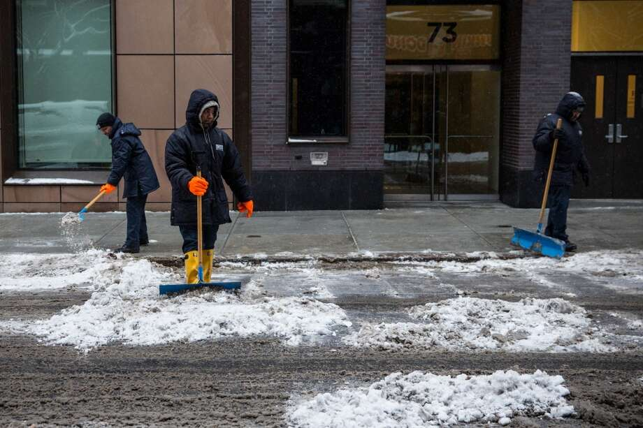 NEW YORK, NY - FEBRUARY 18:  Men shovel a sidewalk on February 18, 2014 in New York City. The city was hit with its 22nd day of snowfall, making for a total of 48 inches for the year.  (Photo by Andrew Burton/Getty Images) Photo: Getty Images