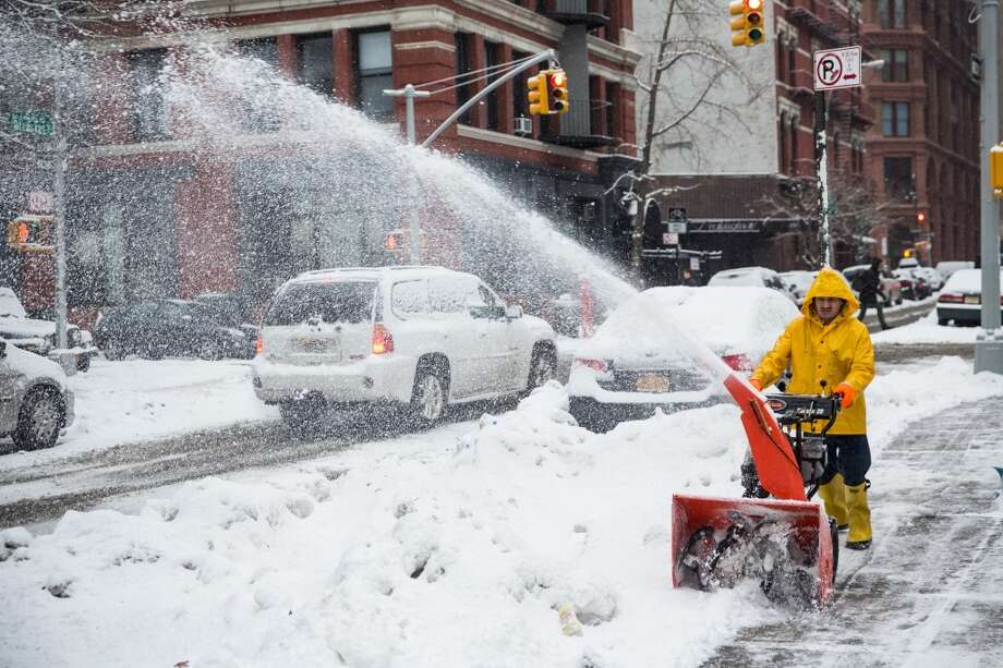 NEW YORK, NY - FEBRUARY 18:  A man uses a snow blower to clear a sidewalk on February 18, 2014 in New York City. The city was hit with its 22nd day of snowfall, making for a total of 48 inches for the year.  (Photo by Andrew Burton/Getty Images) Photo: Getty Images