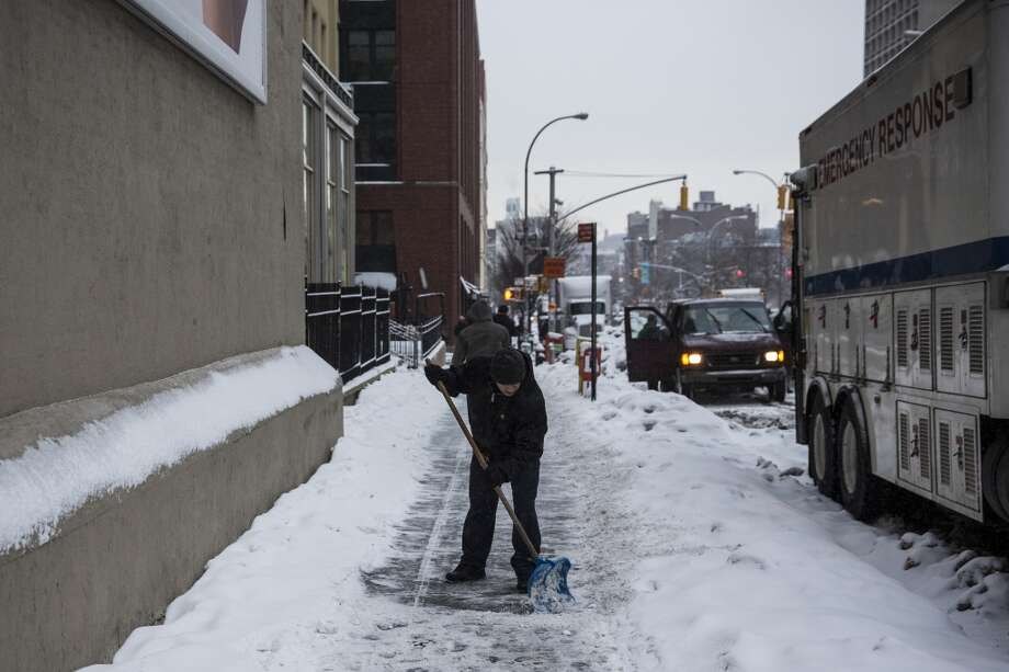 NEW YORK, NY - FEBRUARY 18:  A man shovels a sidewalk on February 18, 2014 in New York City. The city was hit with its 22nd day of snowfall, making for a total of 48 inches for the year.  (Photo by Andrew Burton/Getty Images) Photo: Getty Images