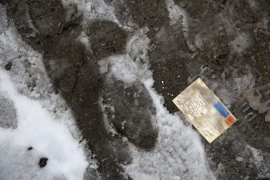 NEW YORK, NY - FEBRUARY 18:  A postcard lies on a slushy sidewalk on February 18, 2014 in New York City. The city has reportedly received a total of about four feet of snow so far in 2014.  (Photo by John Moore/Getty Images) Photo: Getty Images