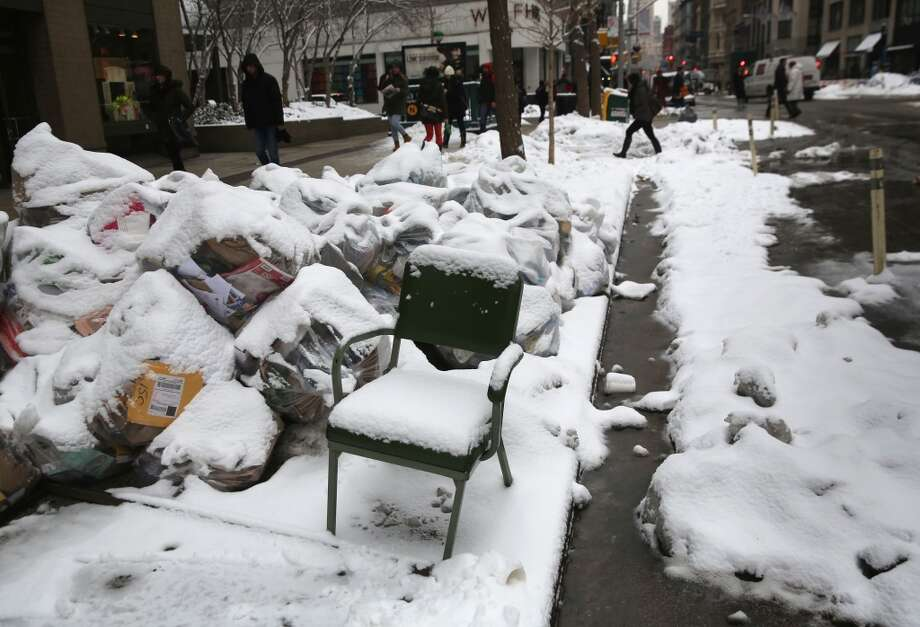 NEW YORK, NY - FEBRUARY 18:  Refuse lies along Broadway on February 18, 2014 in New York City. The city has reportedly received a total of about four feet of snow so far in 2014.  (Photo by John Moore/Getty Images) Photo: Getty Images