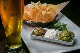 The Chips and Dip with a beer at LB Steak in Menlo Park, Calif., are seen on Wednesday, February 12th, 2014.