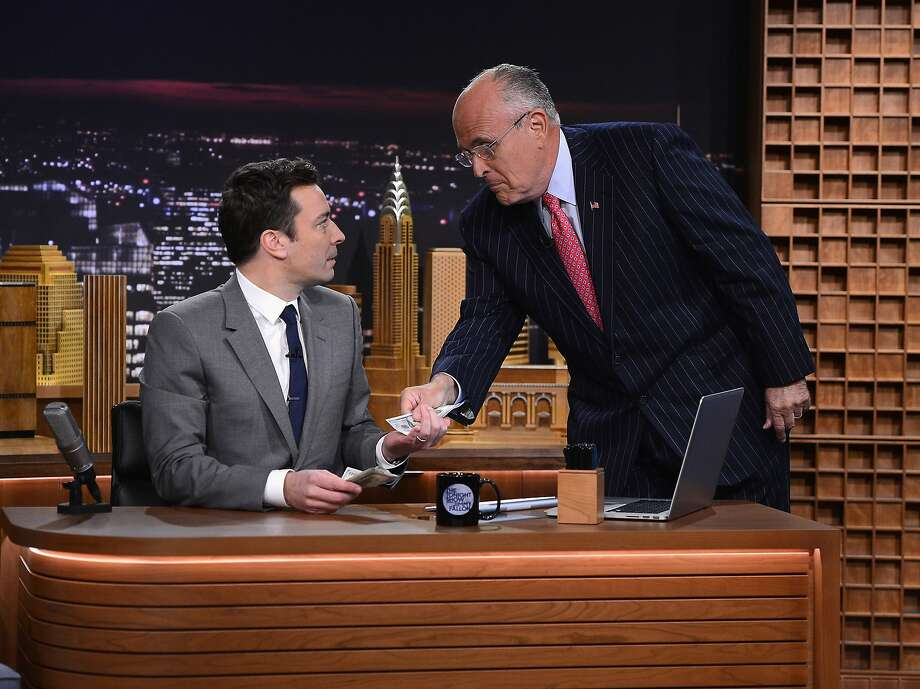"Former New York Mayor Rudy Giuliani drops a C-note on Jimmy Fallon's desk on Fallon's first day on the job as the new host of ""The Tonight Show."" Photo: Theo Wargo, Getty Images For The Tonight Sho"