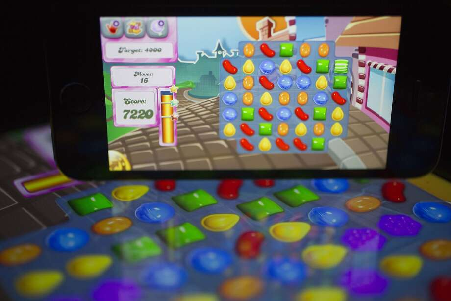 "On average, King Digital Entertainment's ""Candy Crush Saga"" draws 93 million daily active users on various devices. Photo: Andrew Harrer, Bloomberg"