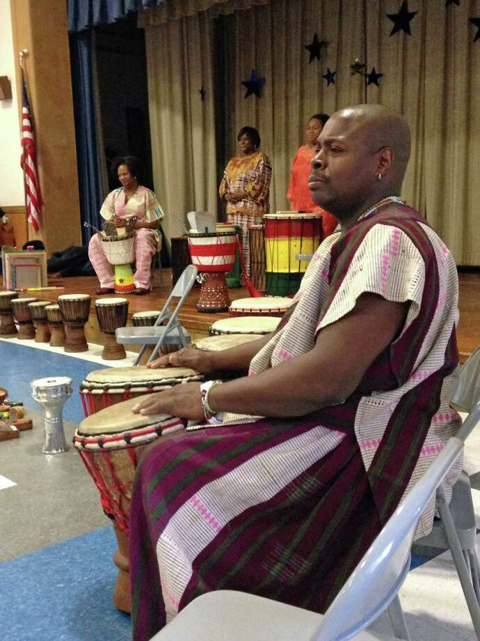 Infinite Roots, a drum troupe, recently visited Royle Elementary School in Darien to demonstrate the instruments and drumming technique to the children. Photo: Contributed Photo, Contributed / Darien News