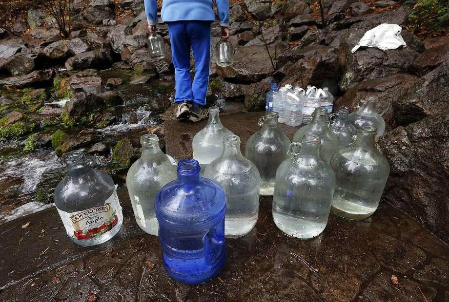 Elora Rizer of Mount Shasta fills water bottles at Spring Hill. Calistoga-based Crystal Geyser has purchased an idle bottling plant nearby and plans to tap the local aquifer again, bottle the water there and sell it. Photo: Michael Macor, The Chronicle