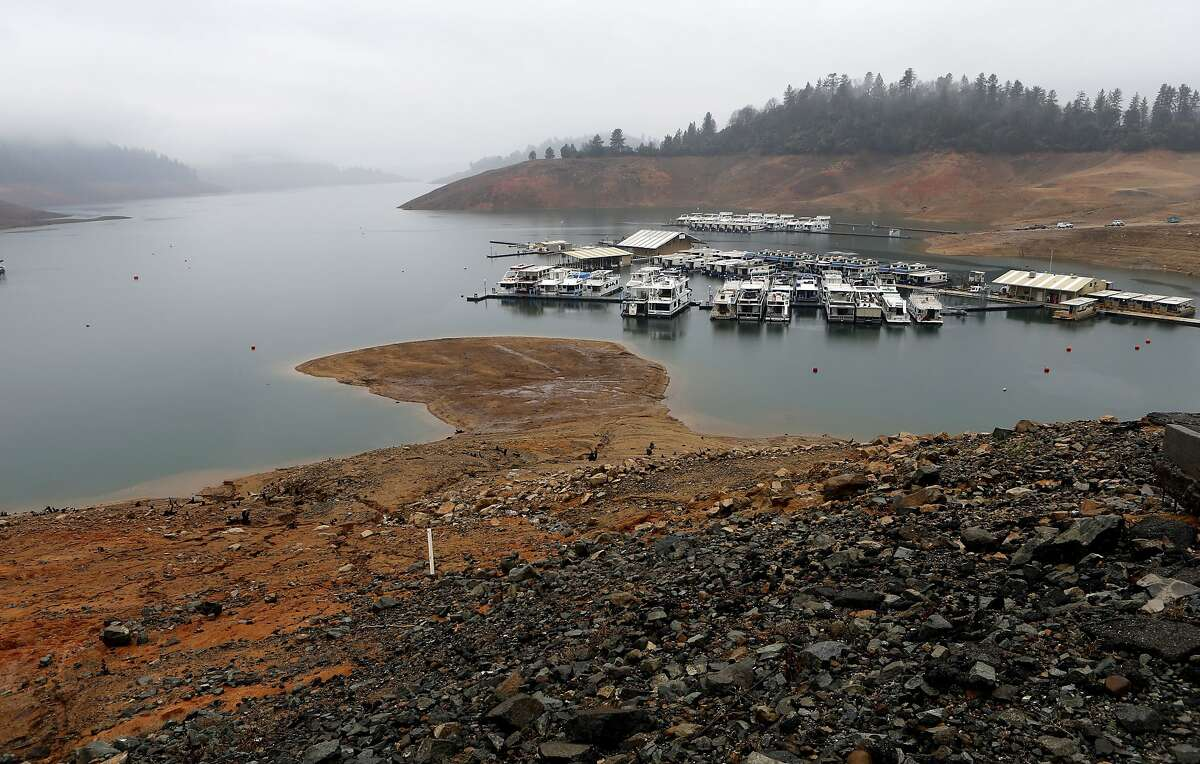 Shasta Lake, on Thursday Feb. 13, 2014, which is fed by the Sacramento River is showing low water levels near Redding, Calif. Crystal Geyser has already purchased an idle Coca Cola bottling plant with plans to pump water from springs at the base of Mt. Shasta. Siskiyou County declared no comprehensive environmental impact report is required. Now battle lines are being drawn jobs and revenue versus aquifer depletion and environmental degradation.