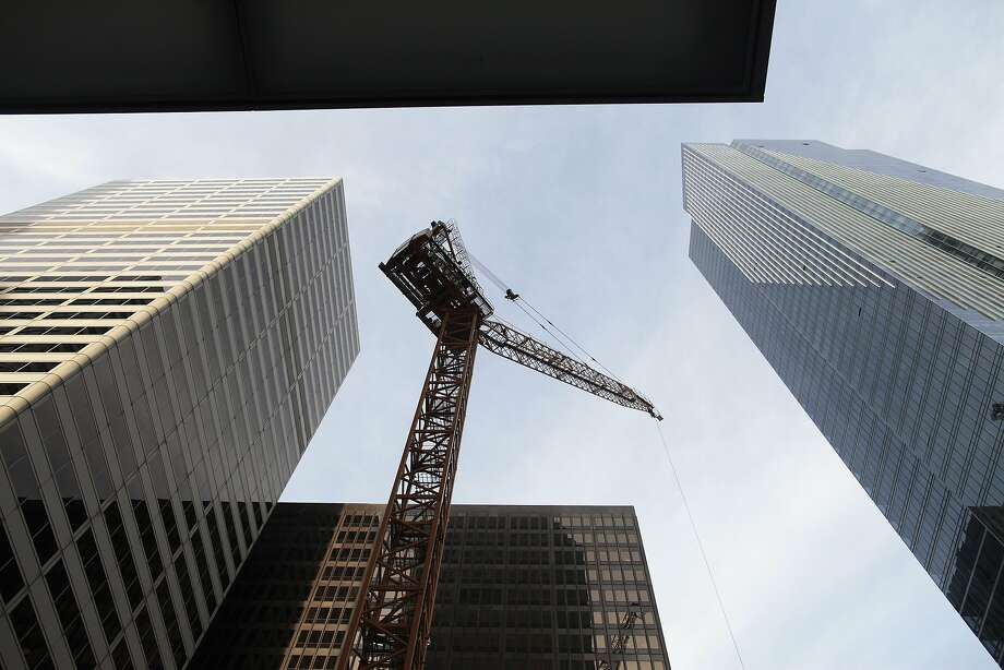 A crane towers over a construction site at 350 Mission St. in San Francisco, Calif. on Thursday, Feb. 13, 2014. The area around First and Mission St. has undergone major physical changes recently with the construction of various towers. Photo: James Tensuan, Special To The Chronicle
