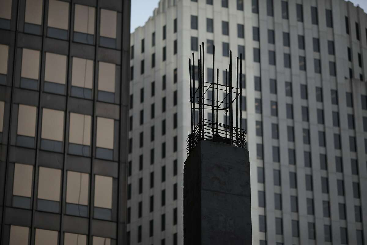 Construction is seen at 350 Mission St. in San Francisco, Calif. on Thursday, Feb. 13, 2014. The area around First and Mission St. has undergone major physical changes recently with the construction of various towers.