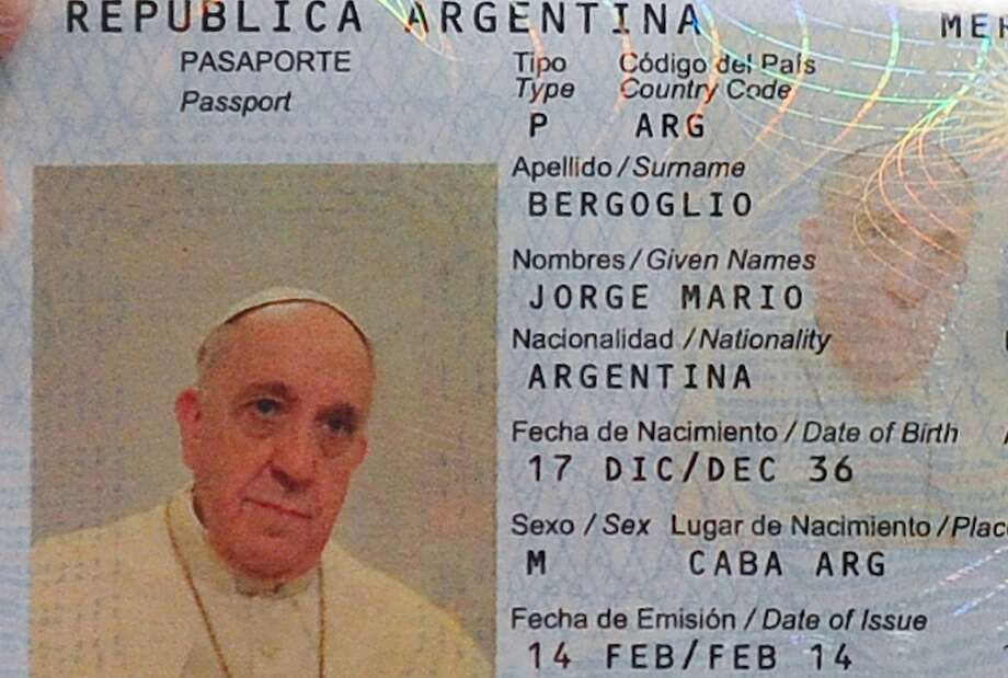 The papal passport:A photo released by Argentina's Interior Ministry shows the new passport of Pope Frances, Jorge Mario Bergoglio, at the Argentine Consulate in Rome. Argentina's ambassador to the Holy See, Juan Pablo Cafiero said he and his deputy went to the Pope's quarters in the Vatican gardens to take Francis' photo and digital fingerprints because the pope's passport was due to expire, and he wanted to renew it. Photo: Argentina's Interior Ministry, Associated Press