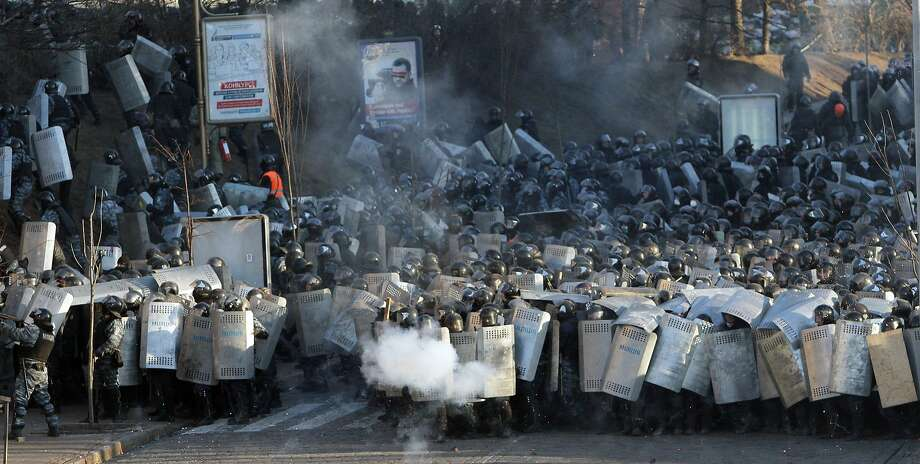 Riot police clash with antigovernment protesters outside Ukraine's parliament building in Kiev. Photo: Anatolii Boiko, AFP/Getty Images