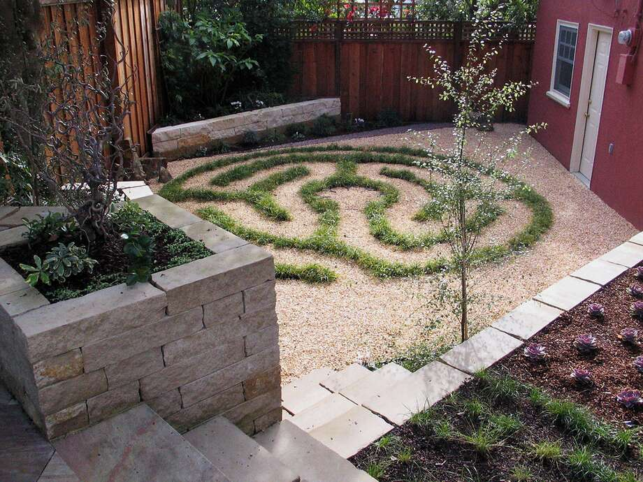 """Living artCreating a serene space topped the list when landscape designer Beth Mullins created this backyard retreat near San Francisco's Glen Park. The owners use their garden mainly to relax and unwind, and dreamed of having their own labyrinth. So Mullins created a living labyrinth outlined with Carex divulsa, an extremely tough and versatile grass-like sedge that can handle sun or shade and take drought once it's established after a couple years of growth. Now mature, the sedge needs very little care or irrigation, and Mullins says, """"Instead of a water or fire feature, this becomes the focal point. It's like having a piece of art in the garden that's functional, and when people gather, you don't have to move it out of the way."""" Photo: Beth Mullins Growsgreen, Growsgreen.com"""