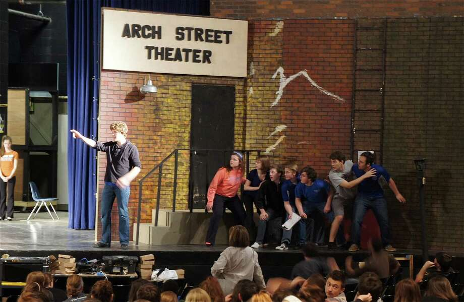 "Students rehearse a scene from ""42nd Street"" at Friendswood High School. The show features a cast of 85, including senior Max Bowen, left, who plays Julian Marsh, director of the show-within-a-show.     Students rehearse a scene from ""42nd Street"" at Friendswood High School. The show features a cast of 85, including senior Max Bowen, left, who plays Julian Marsh, director of the show-within-a-show. Photo: Friendswood ISD"