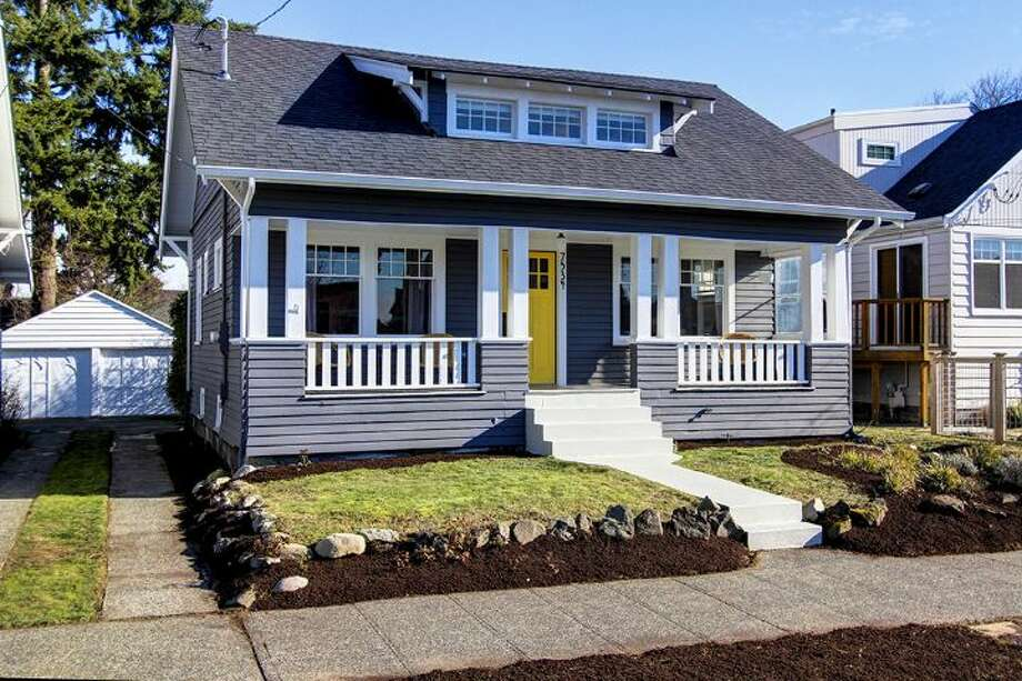 """We'll start with, 7534 19th Ave. N.W., which was built in 1917, but was just overhauled """"down to the studs."""" It's 1,880-square-feet, with three bedrooms, 2.25 bathrooms, reclaimed chalkboards used as kitchen countertops, two basement bed alcoves, a urinal and a front porch on a 3,840-square-foot lot. It's listed for $575,000, although a sale is pending. Photo: Dan Achatz/Courtesy Shannon Hill Hanson And Kay Rigley,  Windermere Real Estate"""