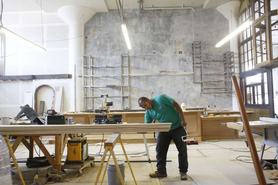 Francisco Resendiz work to finish Magnolia Brewpub founder Dave McLean's new restaurant called Smokestack. McLean plans to open the  restaurant and brauerei in the Dogpatch at the beginning of March, 2014. Photo: Mike Kepka, The Chronicle