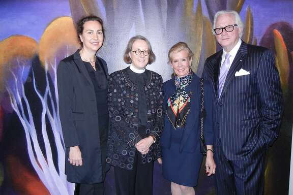 "Fine Arts Museums trustee Sarah Ogilvie and her partner, Jane Shaw, Dean of Grace Cathedral (at left) with ""O'Keeffe"" exhibition co-sponsor Lucinda Watson and her beau, Ted Bell, at the de Young Museum. Feb 2014. By Catherine Bigelow"