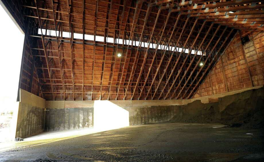 The shed at the Bethel Highway Department that holds the salt and sand used for the roads during winter weather is empty of salt, Tuesday, Feb. 18, 2014. There is still some sand and salt mixture available, but that supply is low also. Photo: Carol Kaliff / The News-Times