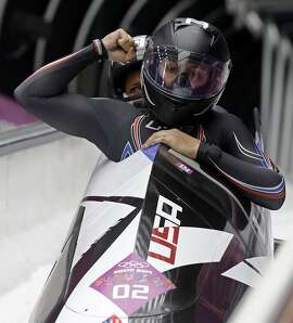 The team from the United States USA-1, piloted by Elana Meyers with brakeman Lauryn Williams, brake in the finish area after their second run during the women's two-man bobsled competition at the 2014 Winter Olympics, Tuesday, Feb. 18, 2014, in Krasnaya Polyana, Russia. (AP Photo/Dita Alangkara)
