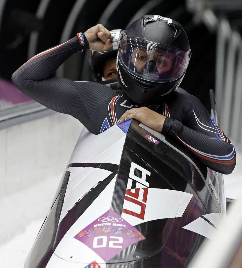 USA-1 pilot Elana Meyers (front) and brakeman Lauryn Williams, a sprinter who has two medals in the Summer Olympics, lead the field after two runs in the two-man bobsled. Photo: Dita Alangkara, Associated Press