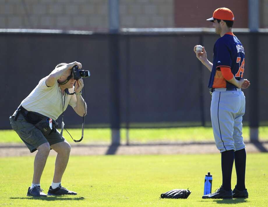 Photographer Steve Moore takes a photo of Mark Appel after pitcher and catcher workouts. Photo: Karen Warren, Houston Chronicle